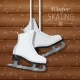White Ice Skates on Wooden Background