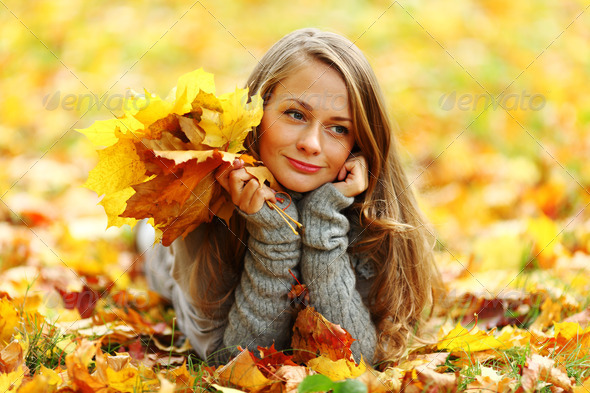 woman portret in autumn leaf - Stock Photo - Images