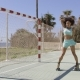 Young Fit Girl in Roller Skates