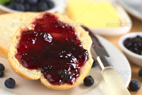 Blueberry Jam on Half a Bun - Stock Photo - Images