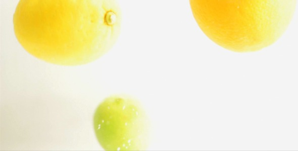 Citrus Fruits Are Dropped Into Water