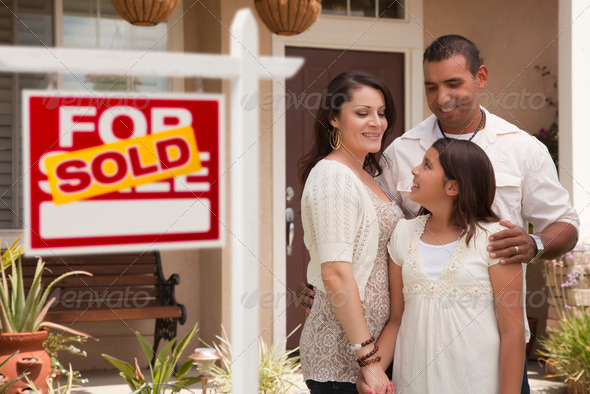 PhotoDune Hispanic Family in Front of Their New Home with Sold Home For Sale Real Estate Sign 1928605
