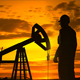 Silhouette Of Crude Oil Pump At Sunset In Oil Field - 18
