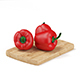 Red Peppers on Wooden Board