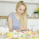 Cheerful Woman Painting Easter Eggs