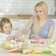 Charming Mother and Daughter Coloring Eggs