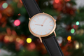 Black leather strap wrist watch in Christmas time