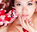 Girl smiling and touch face with red rose - PhotoDune Item for Sale