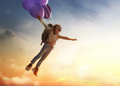 Child flying on balloons
