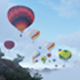 Hot Air Balloons Flying Over Cloudy Mountains