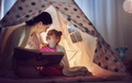Mom and child are reading book