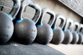 Row of kettlebell or girya weights in a gym