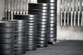 Stacks of assorted sized weights in a gym