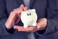 Businesswoman and piggy coin bank