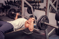 Athletic man exercising in the gym