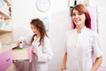 Two pharmacist woman at work place