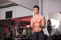 Young healthy bodybuilder exercising in the gym
