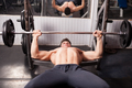 Young bodybuilder exercising in the gym