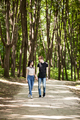 Happy couple taking a walk in the forest