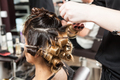 Woman getting a hairstyle in salon