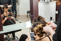 Woman getting a fashion hairstyle in salon