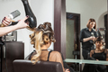 Woman getting a hairstyle