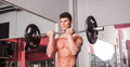 Young athletic man exercising