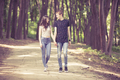 Inlove couple taking a walk in the forest