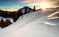 sunrise in snowy winter Alps