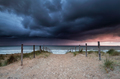 stormy sunset over beach in North sea
