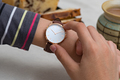Girl's hand with wrist watches at the coffee break