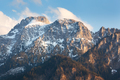 Snowy mountain peaks at sunset in spring