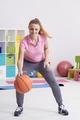Woman practicing basketball