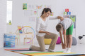 Child exercising with physiotherapist