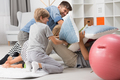 Pillow fight between father and children