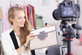 Fashion vlogger presenting woman's bag