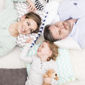 Happy parents and baby lying together