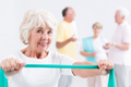 Woman holding exercise band
