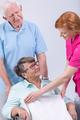 Caregiver helping woman on wheechair