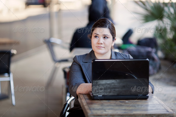 Businesswoman - Telecommuting from Internet Cafe - Stock Photo - Images