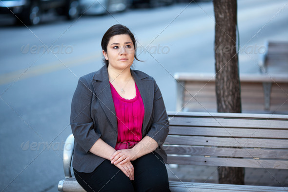 Businesswoman - Relaxing on a bench - Stock Photo - Images