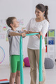 Child exercising with resistance band