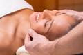 Beautiful woman having face massage