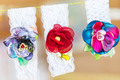 Beautiful textile brooches from artificial flowers.