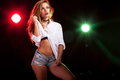 Hot sexy woman in white shirt with two lights from behind
