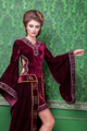 Romantic woman dressed in vintage clothes in retro interior