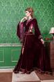 Romantic woman dressed vintage clothes in retro interior