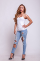 Beautiful woman in jeans and white shirt