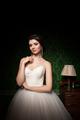 Beautiful bride in green vintage interior
