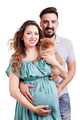 Pregnant woman with her husband and dog